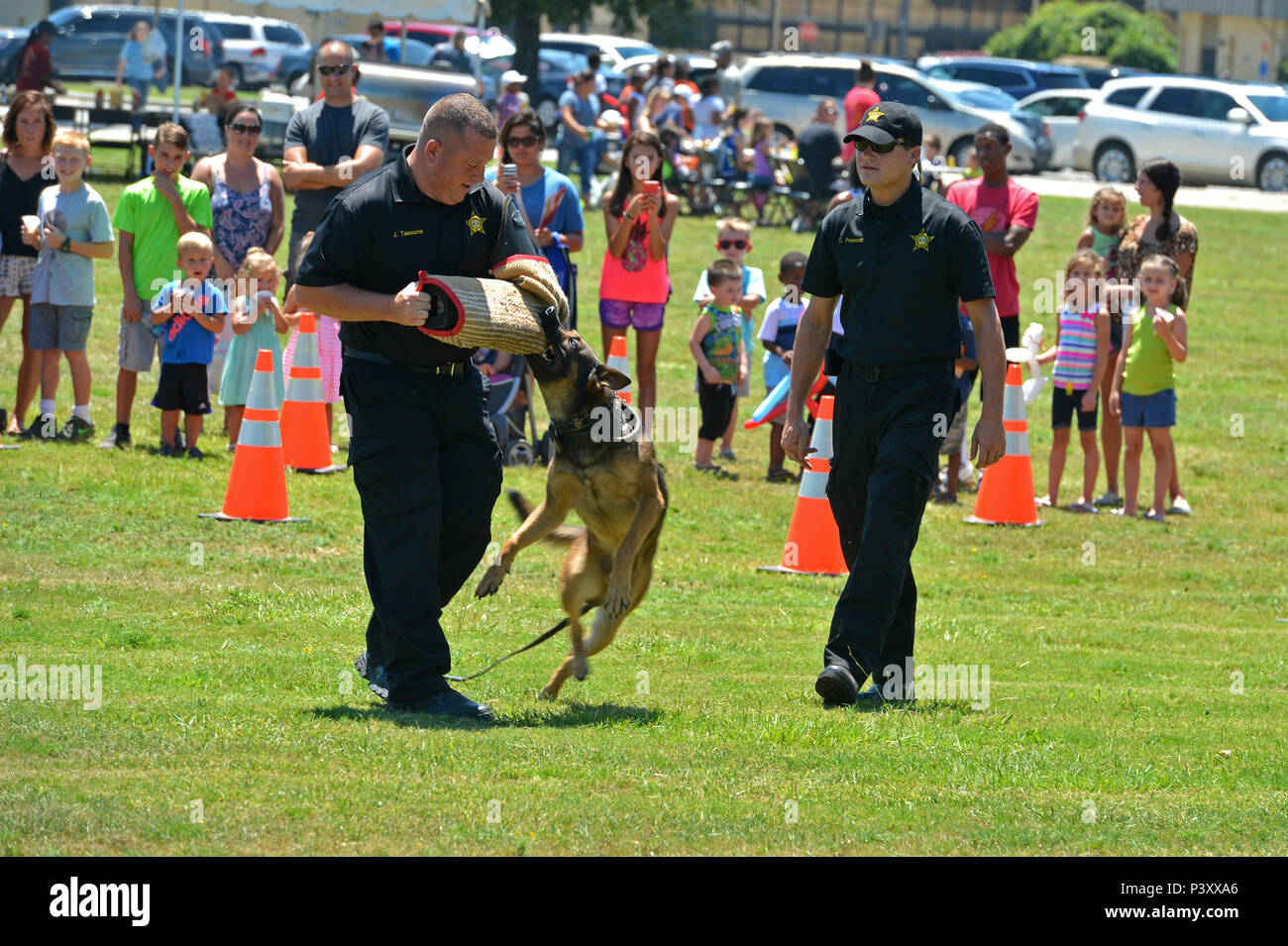 Sumter City Police Department officers performs a K-9 demonstration during the Exceptional Family Member Program Kid's Jamboree at Shaw Air Force Base, S.C., July 27, 2016. The event provided Team Shaw families the opportunity to receive school supplies, play in bounce houses and receive standard health screenings before the beginning of the school year. (U.S. Air Force photo by Airman 1st Class Christopher Maldonado) - Stock Image