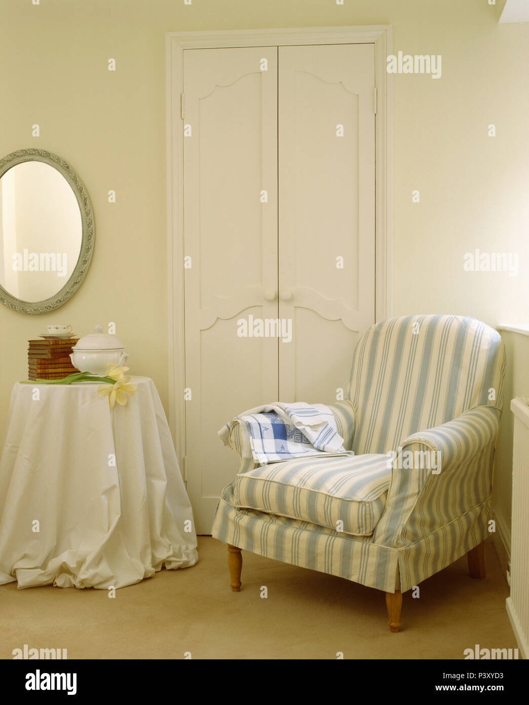 Blue White Striped Loose Cover On Armchair In Corner Of Dining Room With White Cloth On Small Side Table Stock Photo Alamy