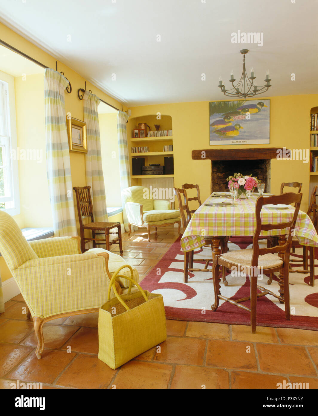Yellow Checked Armchair And Basket In Country Dining Room With Red White Patterned Rug