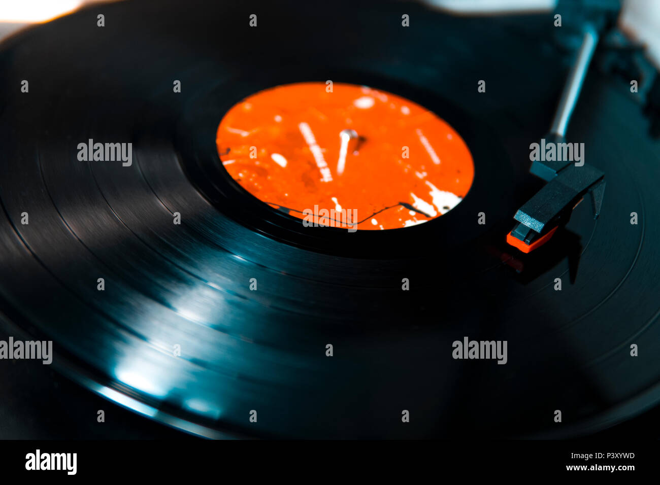 Vinyl Disc Playing on a Record Player - Stock Image