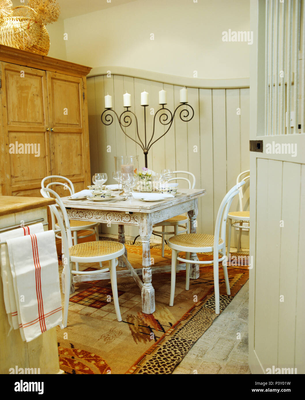 White Bentwood Chairs And Painted Table In Small Dining Room In Converted  Stable With Grey Painted Panelling