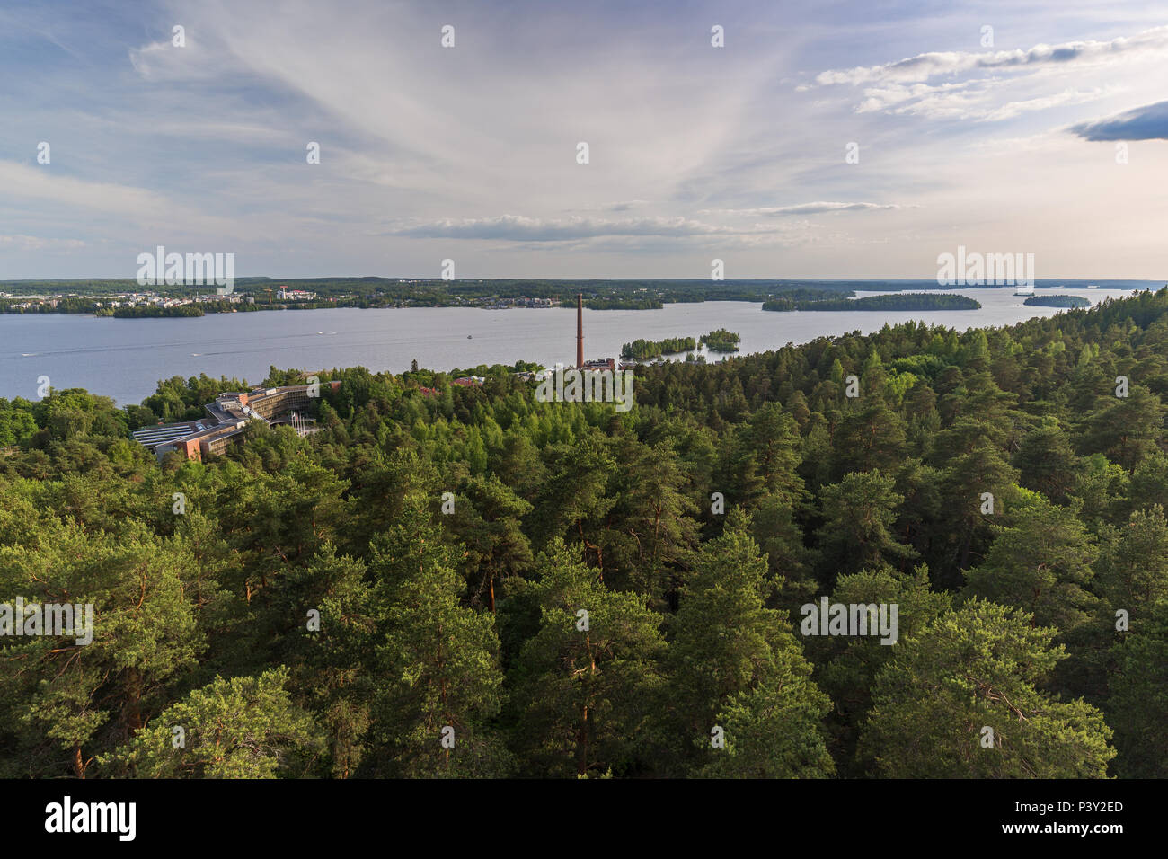 Buildings, forest at the Pyynikki ridge, Lake Pyhäjärvi and beyond in Tampere, Finland, viewed from above on a sunny day in the summer. - Stock Image