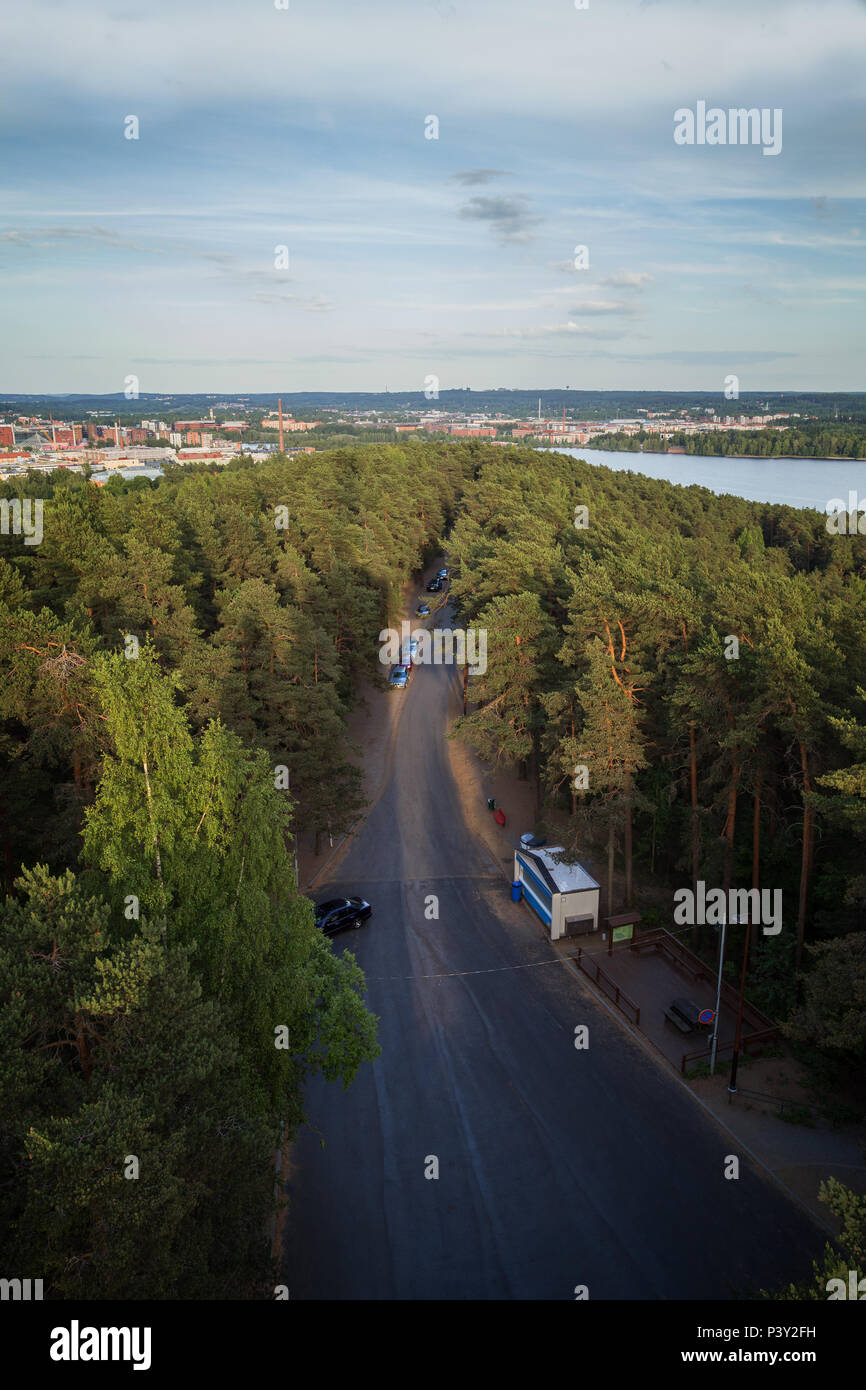 City of Tampere, Finland, and lush trees at the Pyynikki ridge viewed from above on a sunny day in the summer. Stock Photo