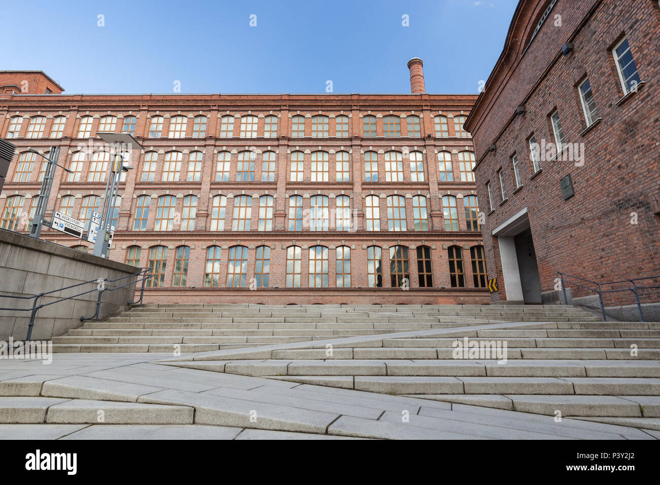 Stairs and old red brick industrial buildings in downtown Tampere, Finland on a sunny day. Stock Photo