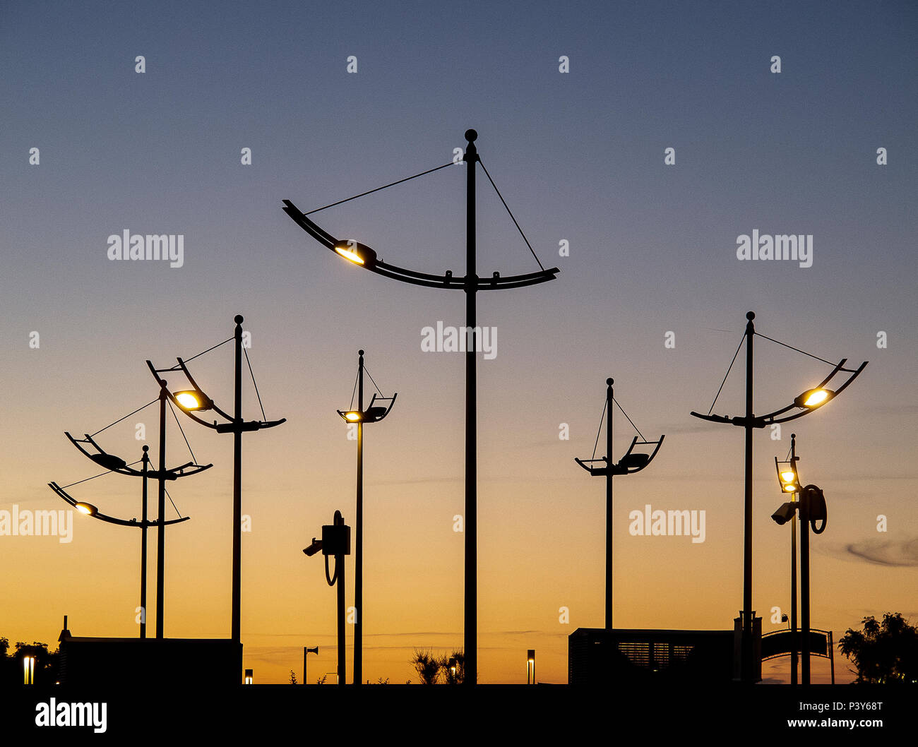 street lamps lit at sunset on the Adriatic coast - Stock Image
