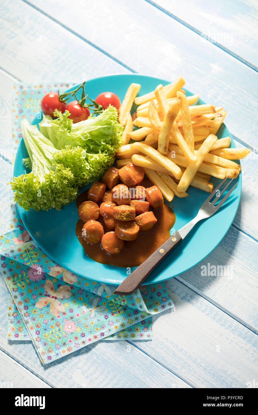 Currywurst mit Pommes, Fastfood - Stock Image