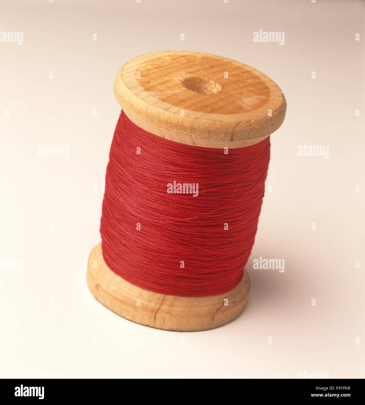 Wooden thread spool, an original from old sewing machines - Stock Image