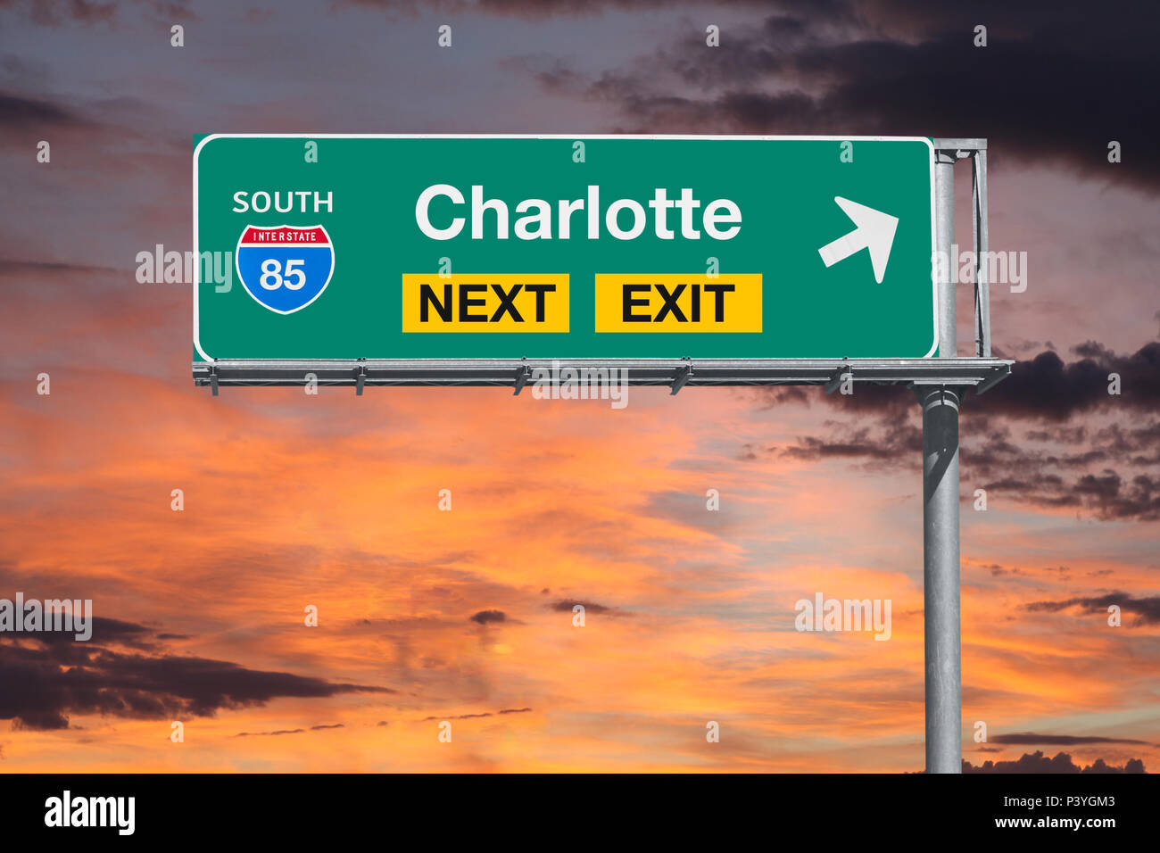 Charlotte North Carolina route 85 freeway next exit sign with sunset sky. - Stock Image