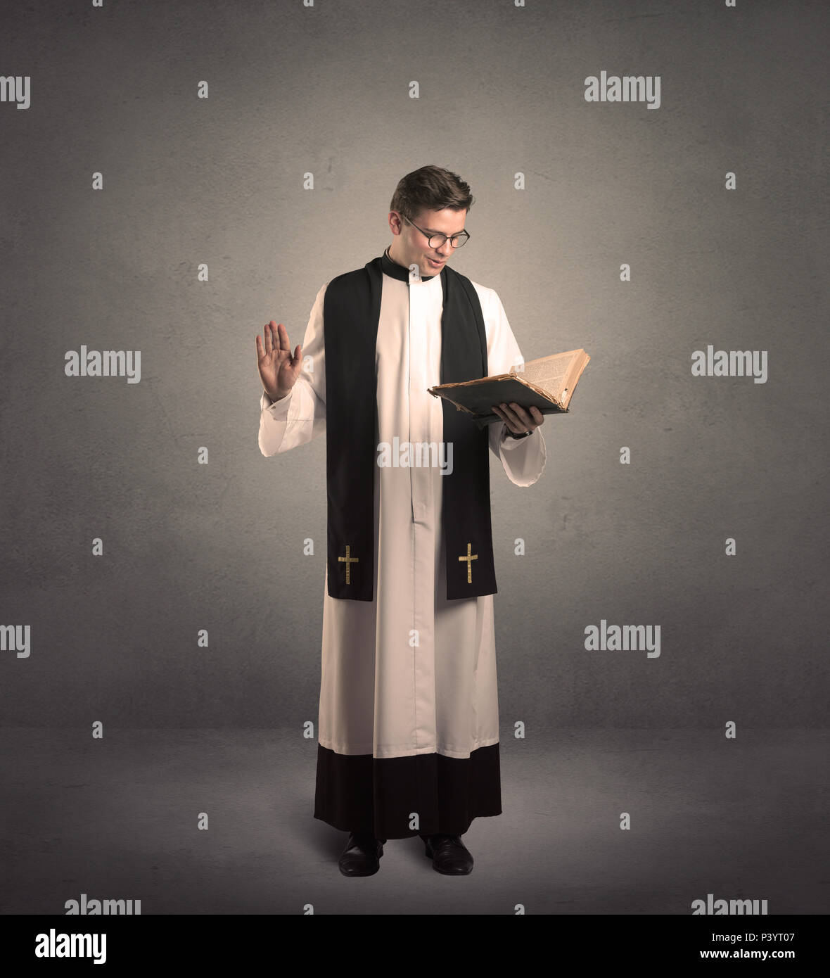 young priest in giving his blessing - Stock Image