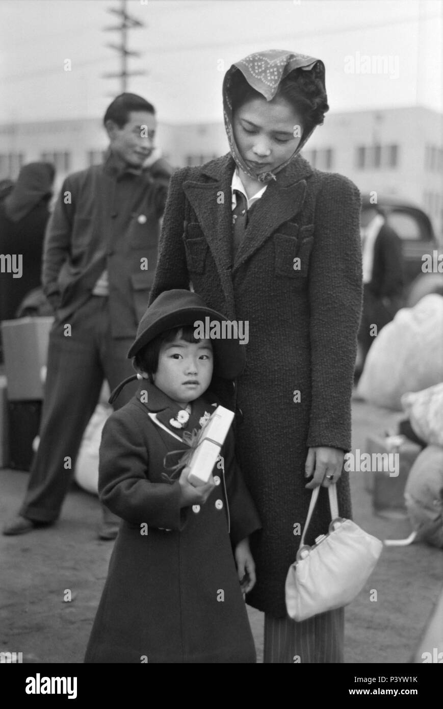 Japanese-American Mother and Daughter Waiting for Train to