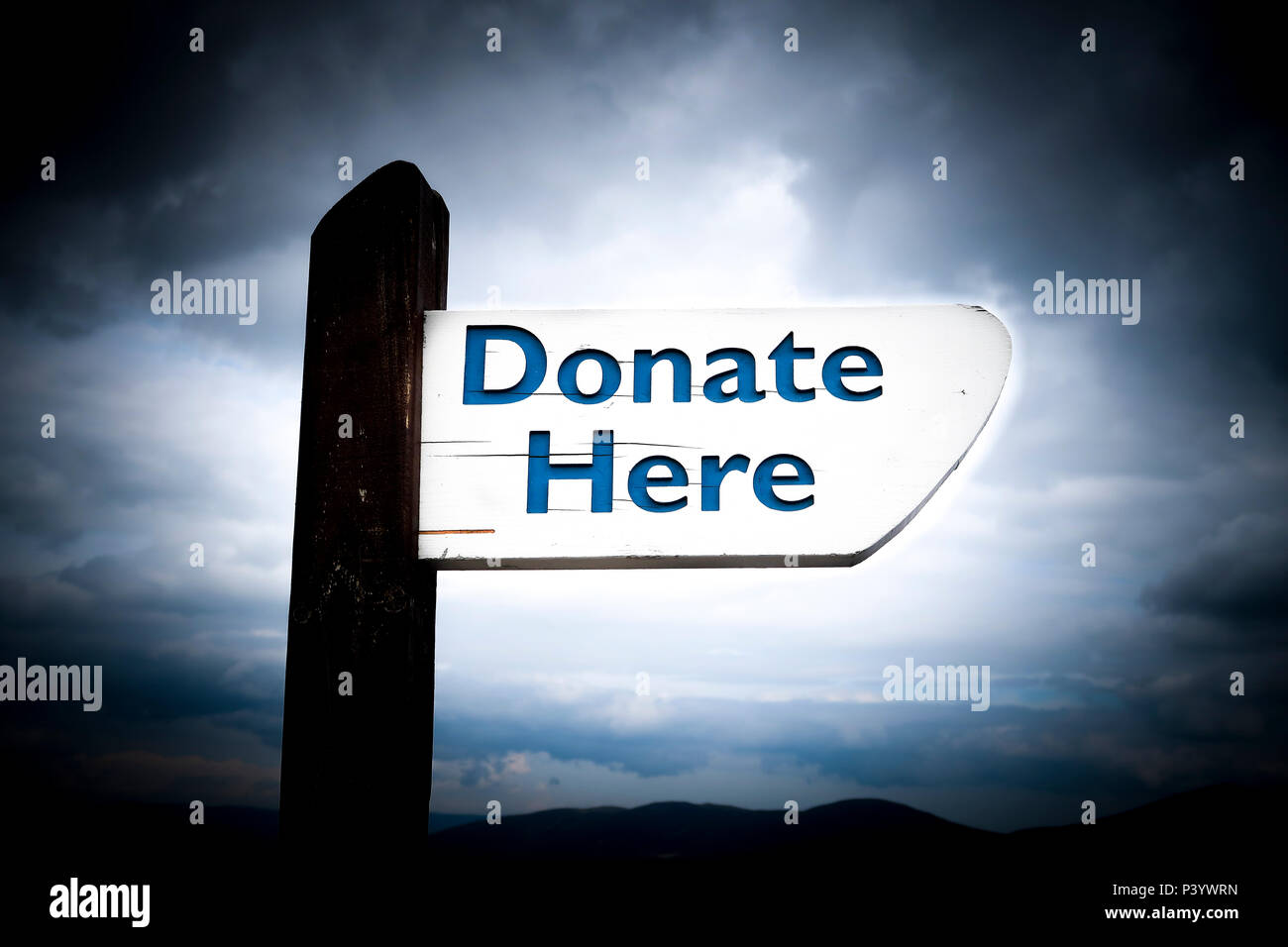 Donate here sign - Stock Image