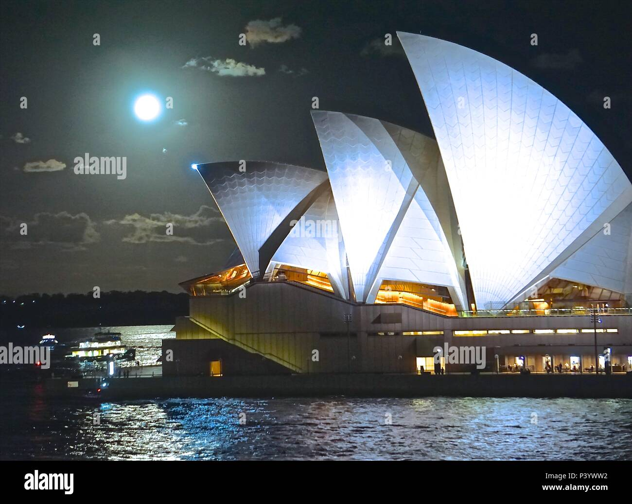 Sydney Opera House evening view with moon - Stock Image