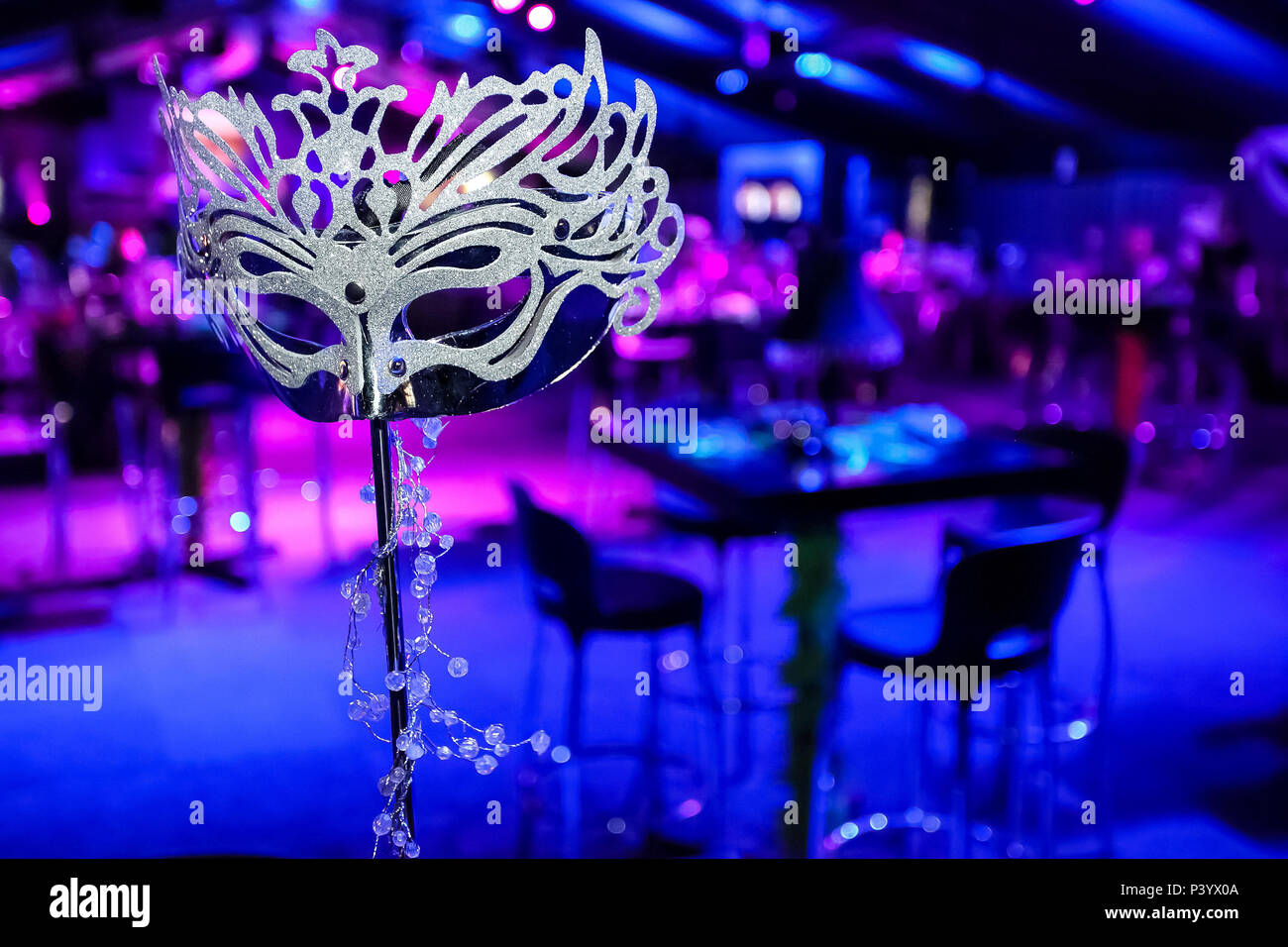 601ea7cf0049 Pink and Purple Blue Decor Masquerade Mask at corporate event or gala  dinner · Sunshine Seeds / Alamy Stock Photo