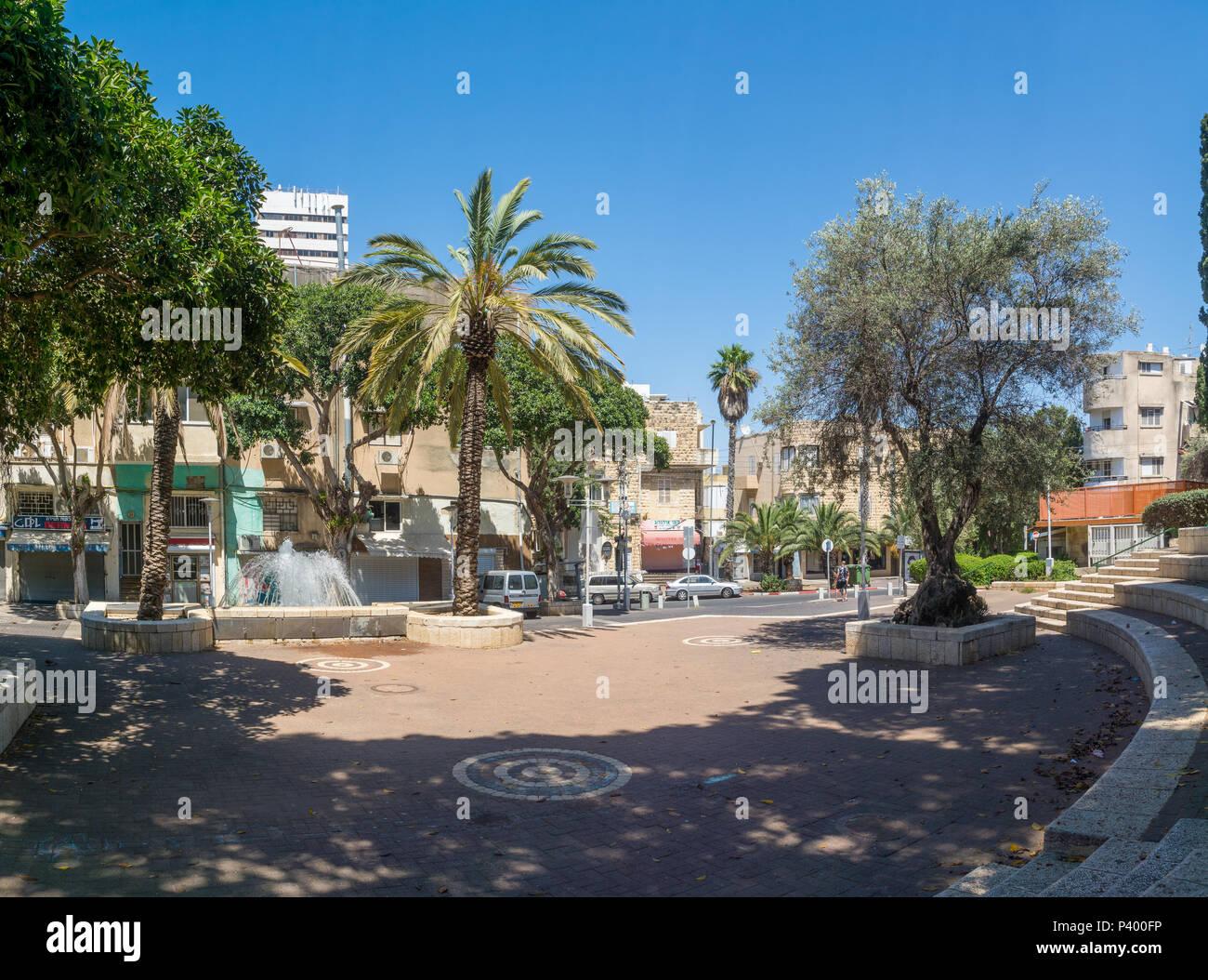 HAIFA, ISRAEL - JUNE 09, 2018: The Binyamin garden, fountain and Nordau street, with locals, in Hadar HaCarmel neighborhood, Haifa, Israel - Stock Image