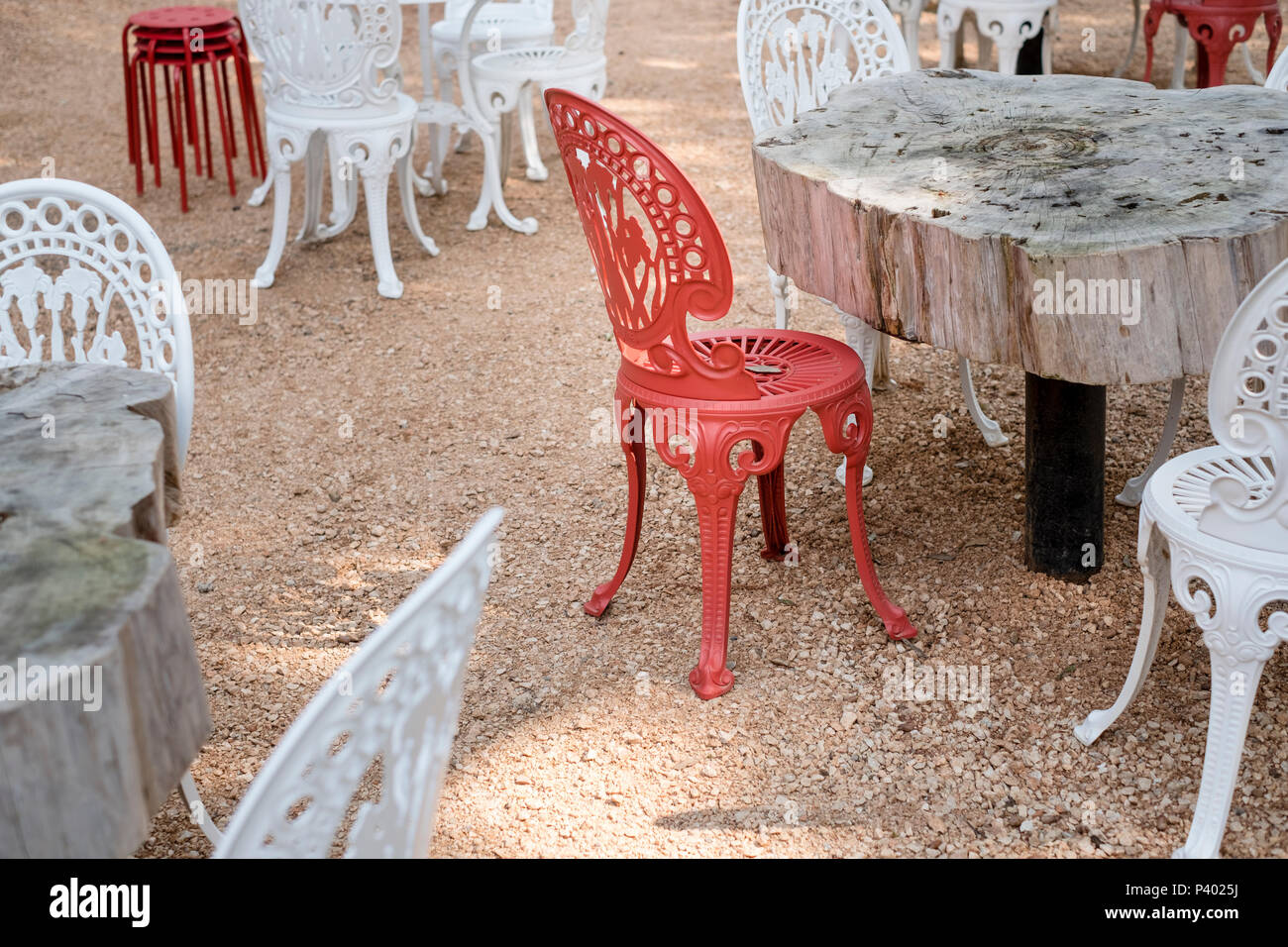 Picture of: Red And White Metal Chairs And Handmade Tables Made Out Of Cut Trees Outdoors Cozy Vintage Style Waiting For Guests In Summer Stock Photo Alamy