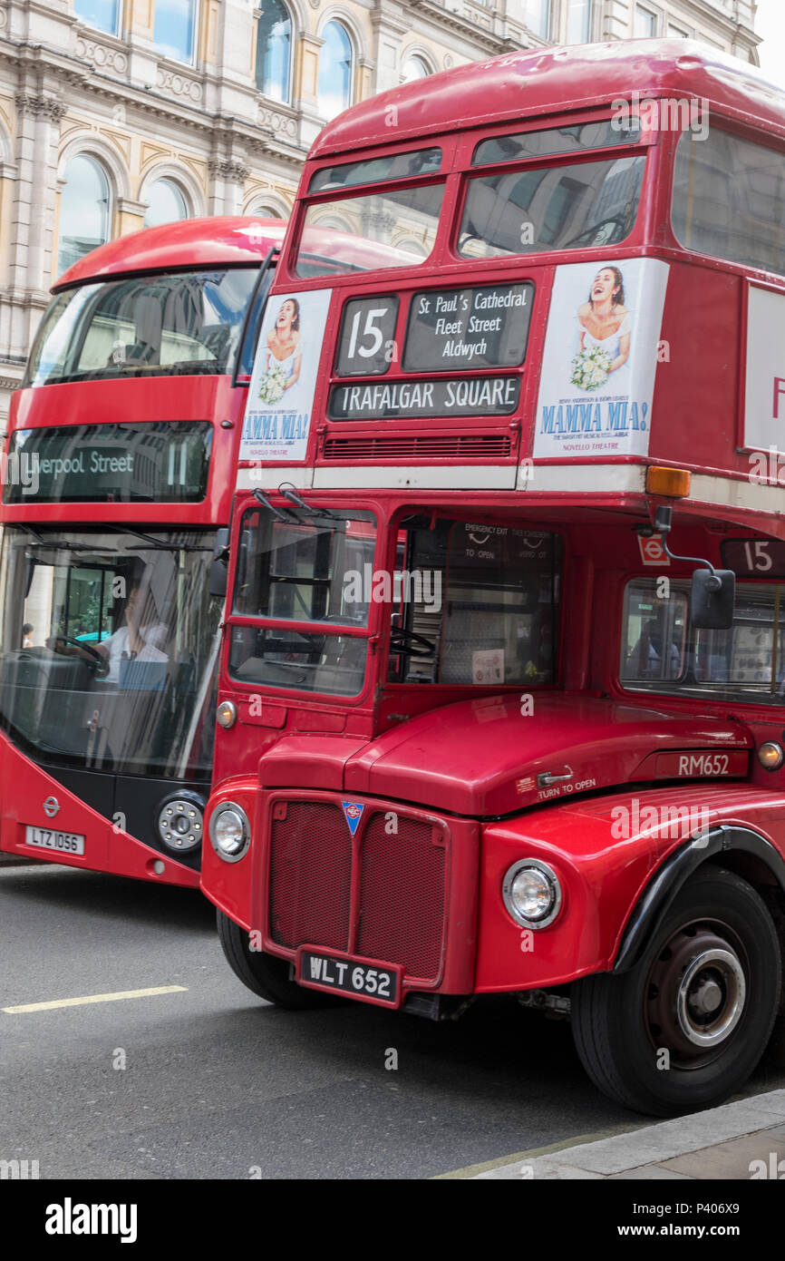 old and new routmaster double-decker busses in central london. - Stock Image