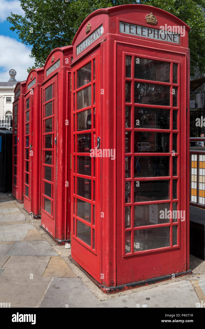 red post office telephone kiosks or call boxes - Stock Image