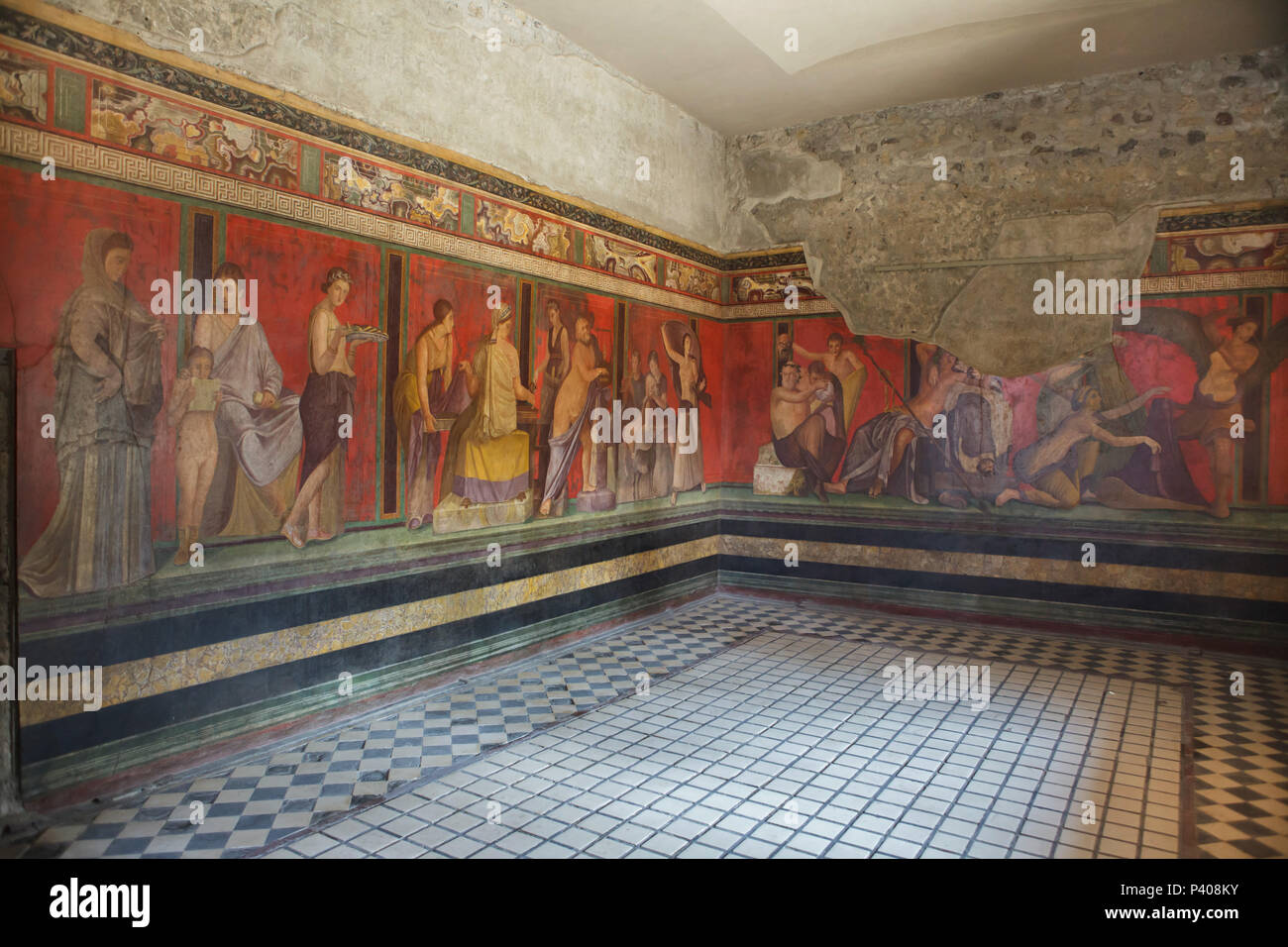 Dionysian Mysteries (Bacchian Mysteries) depicted in the Roman frescos in the triclinium (Roman dining room) in the Villa of the Mysteries (Villa dei Misteri) in the archaeological site of Pompeii (Pompei) near Naples, Campania, Italy. Initiation rite from the mysterious cult of Dionysus (Bacchus) is probably depicted in the frescoes. Stock Photo