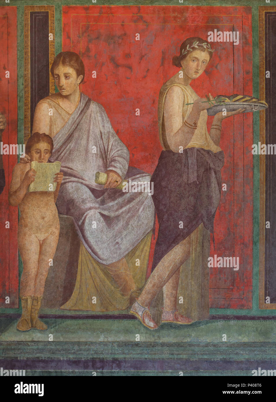 Dionysian Mysteries (Bacchian Mysteries) depicted in the Roman fresco in the triclinium (Roman dining room) in the Villa of the Mysteries (Villa dei Misteri) in the archaeological site of Pompeii (Pompei) near Naples, Campania, Italy. Initiation rite from the mysterious cult of Dionysus (Bacchus) is probably depicted in the murals. This fresco shows a priestess or matron seated on a throne, by which stands a small boy reading a scroll - presumably the declaration of the initiation. On the other side of the throne the young initiate is shown in a purple robe and myrtle crown, holding a sprig of Stock Photo