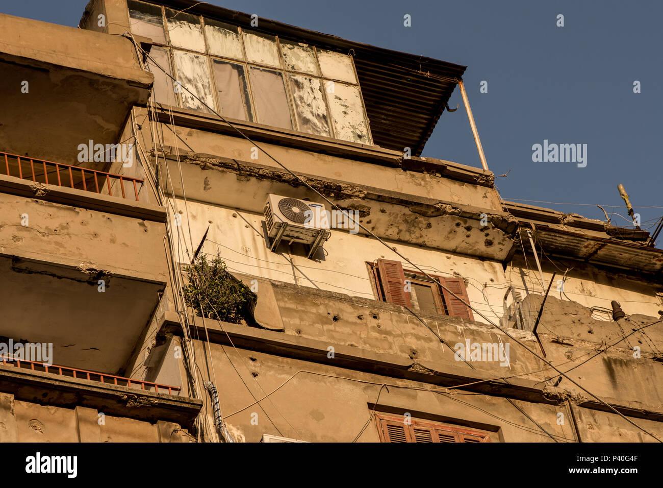 Bullet ridden building - Stock Image