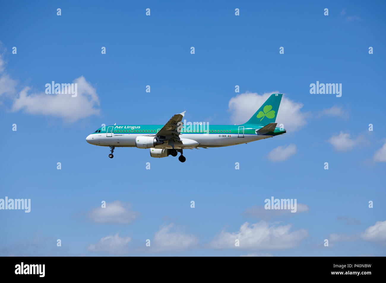 An Air Lingus Airbus A320-214 aircraft, registration number EI-DER, nickname St Mel, approaching a landing. - Stock Image
