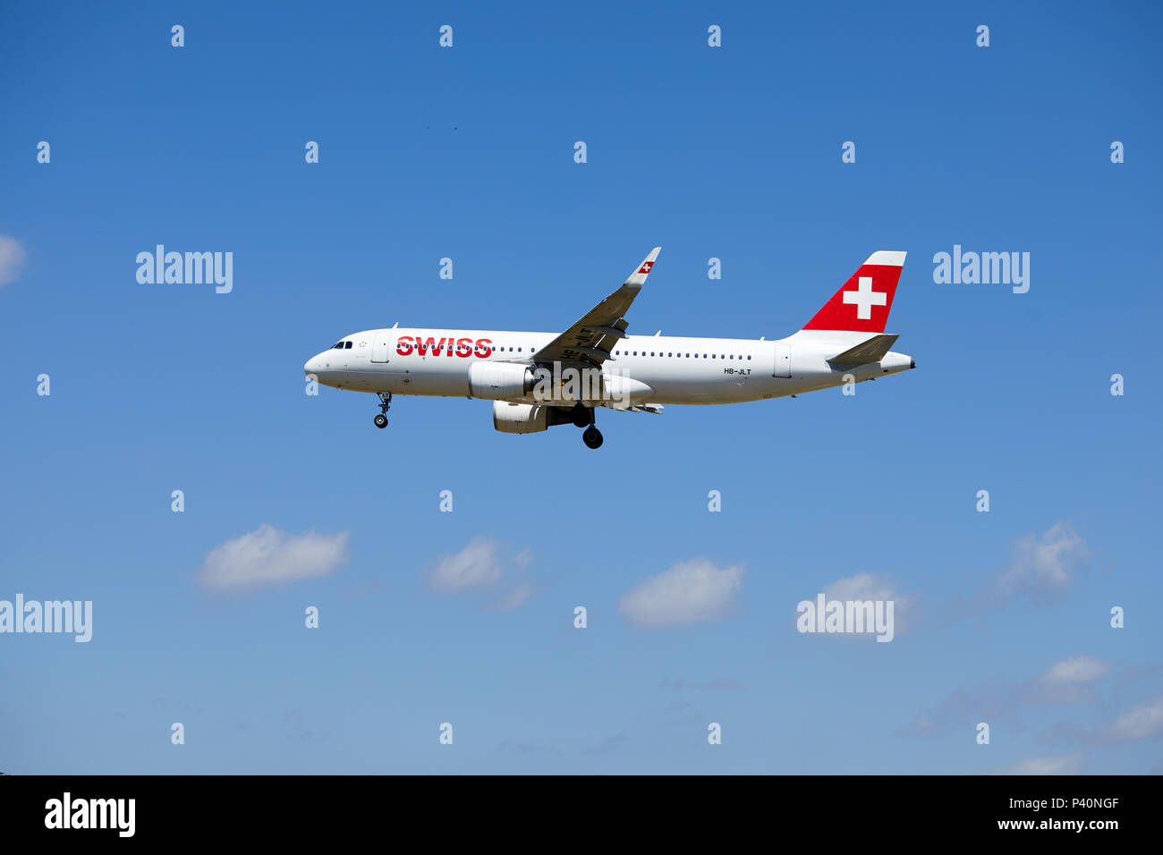 A Swiss Air Airbus A320-214 aircraft, registration number HB-JLT, nickname Grenchen, approaching a landing. - Stock Image