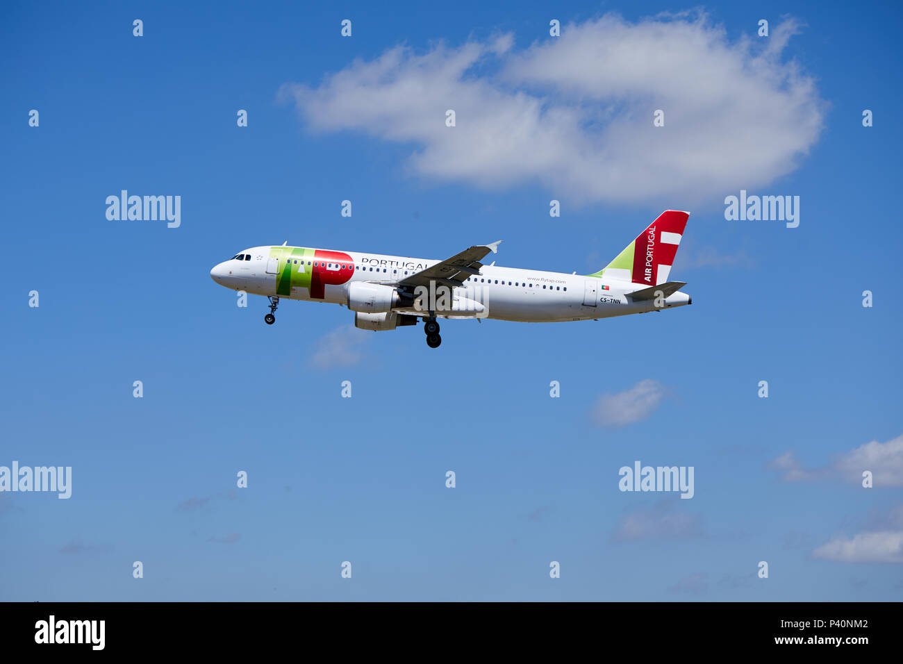 A TAP Air Portugal Airbus A320-214 aircraft, registration number CS-TNN, approaching a landing. - Stock Image