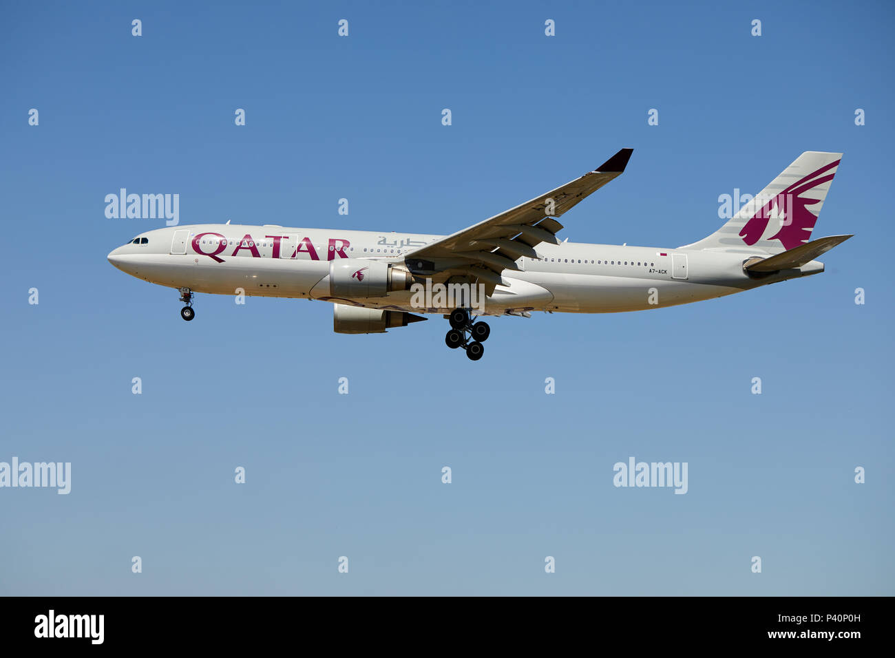 A Qatar Airways Airbus A330-202 aircraft, registration number A7-ACK, approaching a landing at Heathrow Airport, London. - Stock Image