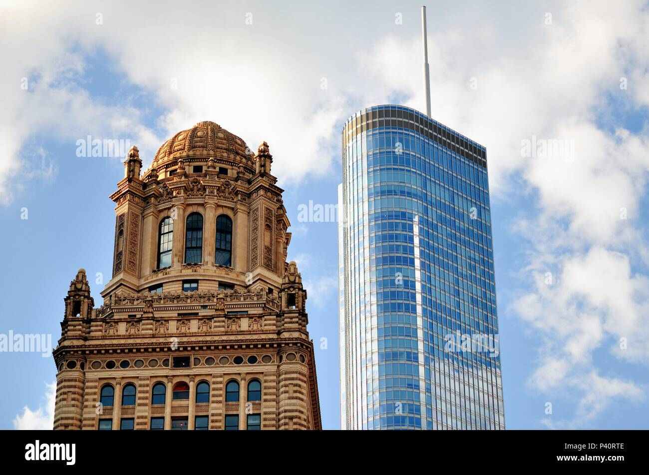 Chicago, Illinois, USA. The tops of two contrasting architectural styles and eras in Chicago that show its diversity and variety of architecture. - Stock Image