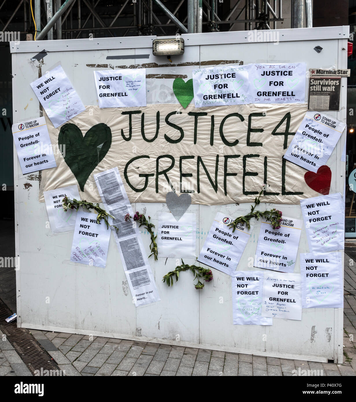 Collage board Justice 4 Grenfell by Stand up to Racism, an arm of the Socialist Workers Party, in Birmingham City Centre, England, UK - Stock Image