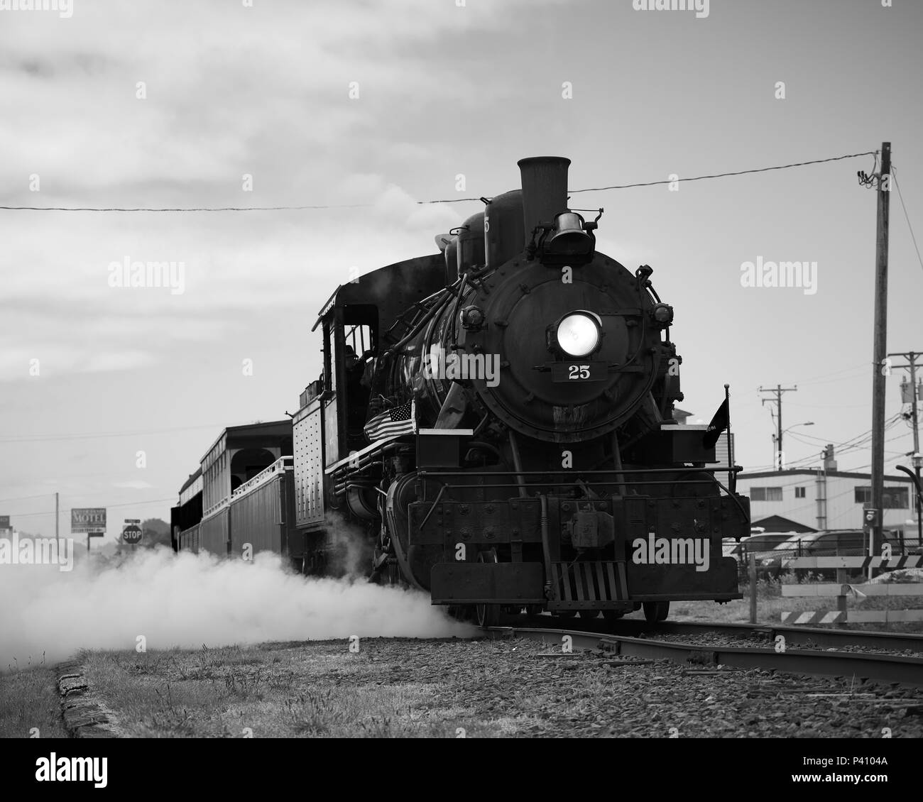 Steam vents from the old locomotive operated by the Oregon Coast Scenic Railway at its destination in Rockaway Beach - Stock Image