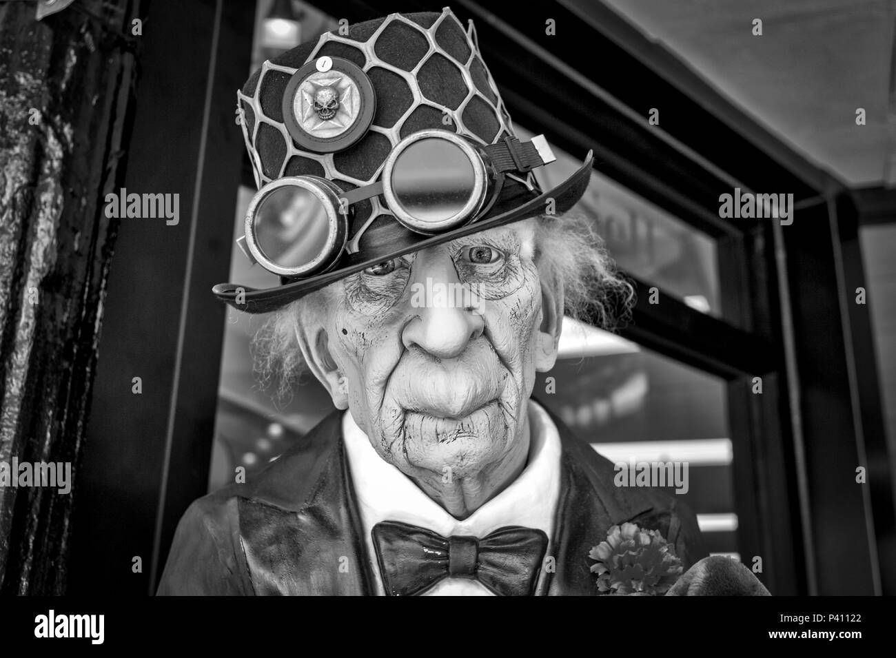 portrait of an old man mannequin dressed in steampunk fashion outside a store in Tarpon Springs, Florida USA - Stock Image