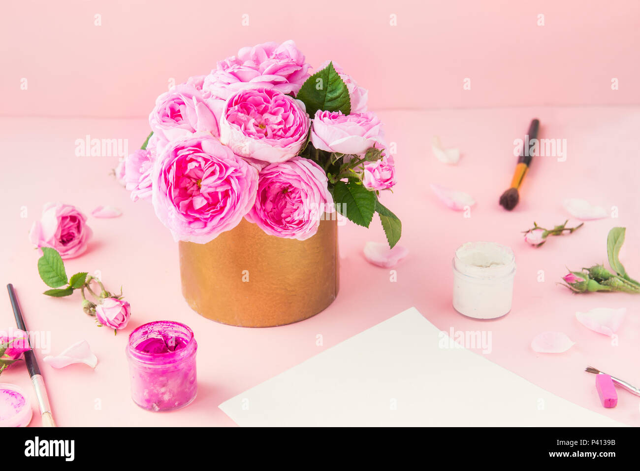 Pink Tea Roses Bouquet In Vintage Pot And Art Materials Paper