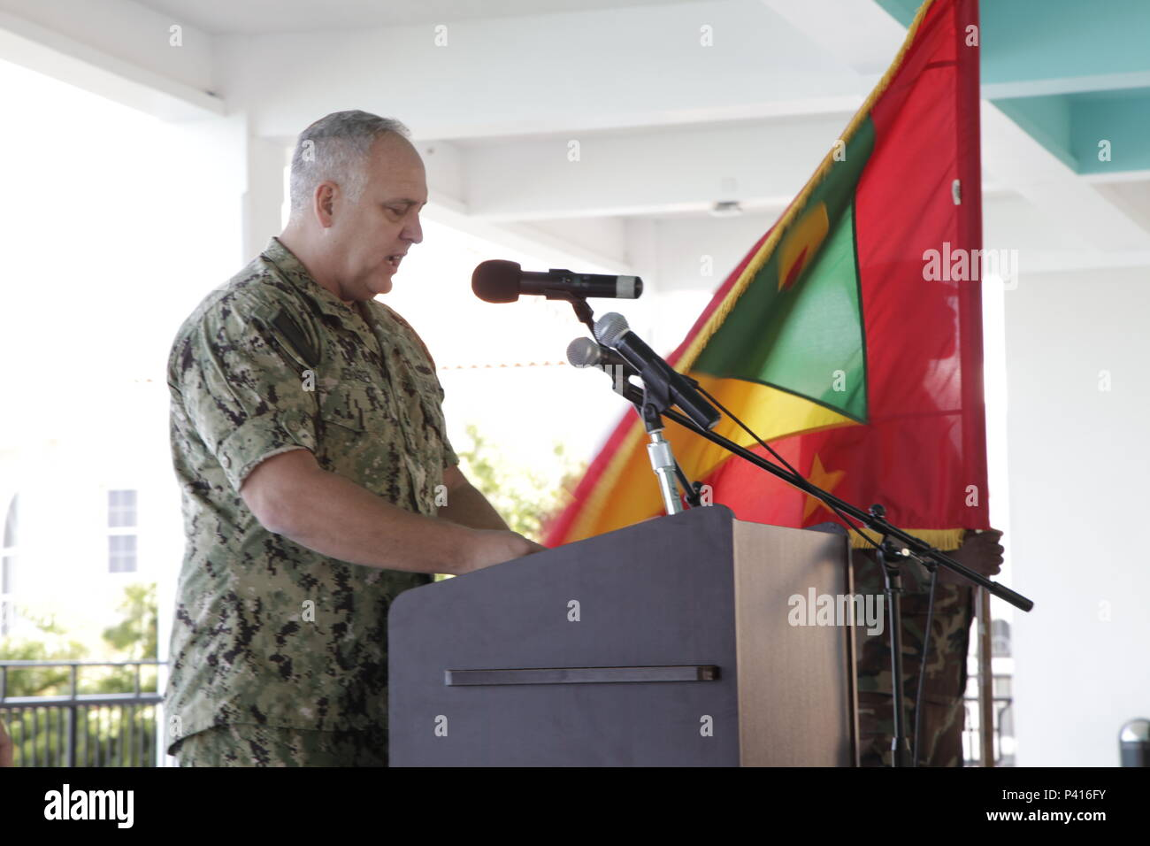 Navy Rear Adm. Scott Jerabek, theatre engagement director for U.S. Southern Command, speaks during the opening ceremony of Tradewinds 2016 in St. George's, Grenada, Jun 5, 2016.  Tradewinds 2016 is a joint combined exercise conducted in conjunction with partner nations to enhance the collective abilities of defense forces and constabularies to counter transnational organized crime and to conduct humanitarian/disaster relief operations. Royal Bahamas Defense Force photo by Marine Seaman Michael Turner Stock Photo