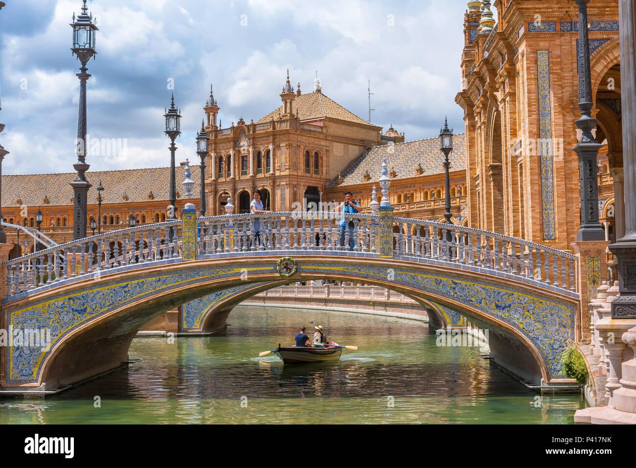 Seville Plaza de Espana, view of a colorful azulejo decorated bridge spanning the boating lake in the Plaza de Espana in Seville, Andalucia, Spain. - Stock Image
