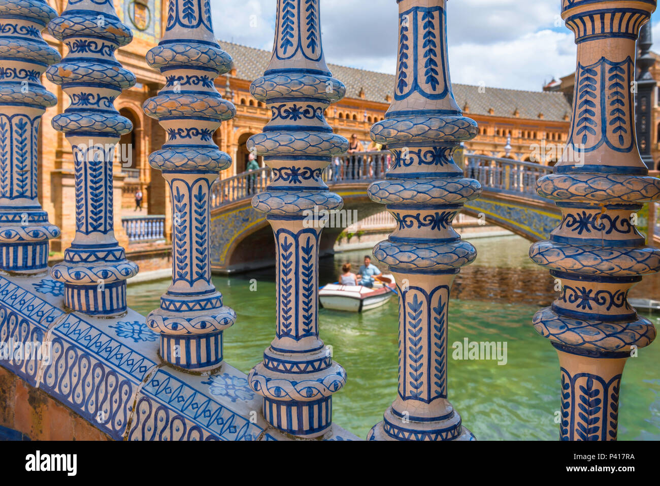 Plaza de Espana Seville, detail of the colorful ceramic balusters of a bridge spanning the lake in the Plaza de Espana, Sevilla, Andalucia, Spain. - Stock Image