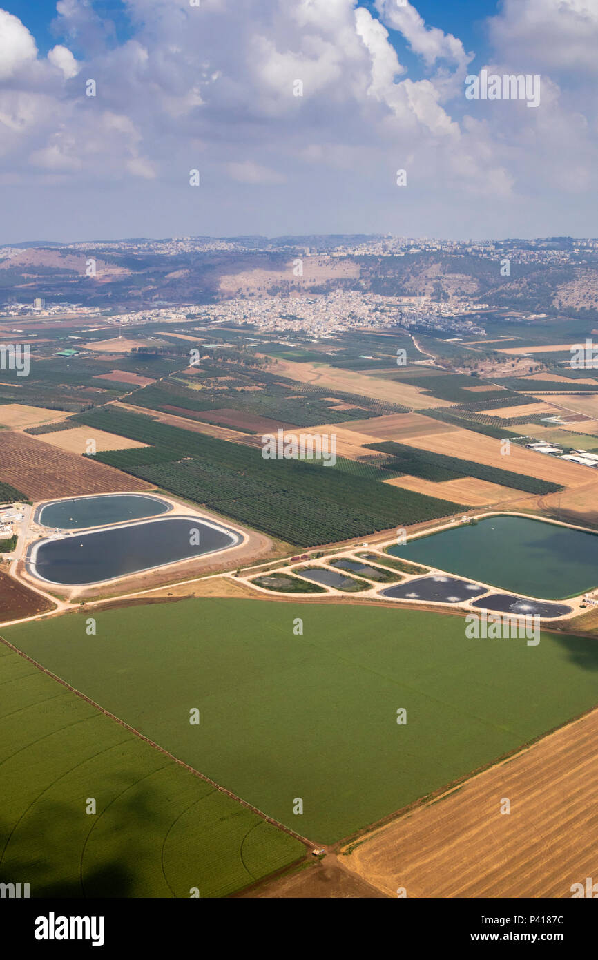 Agricultural landscape with fish breeding ponds in Jezreel Valley, northern Israel, aerial view - Stock Image