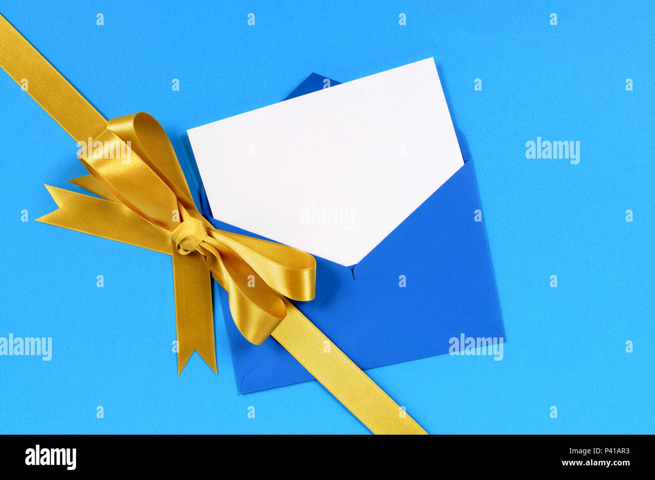 Blue And Gold Gift With Blank Invitation Or Greetings Card Stock