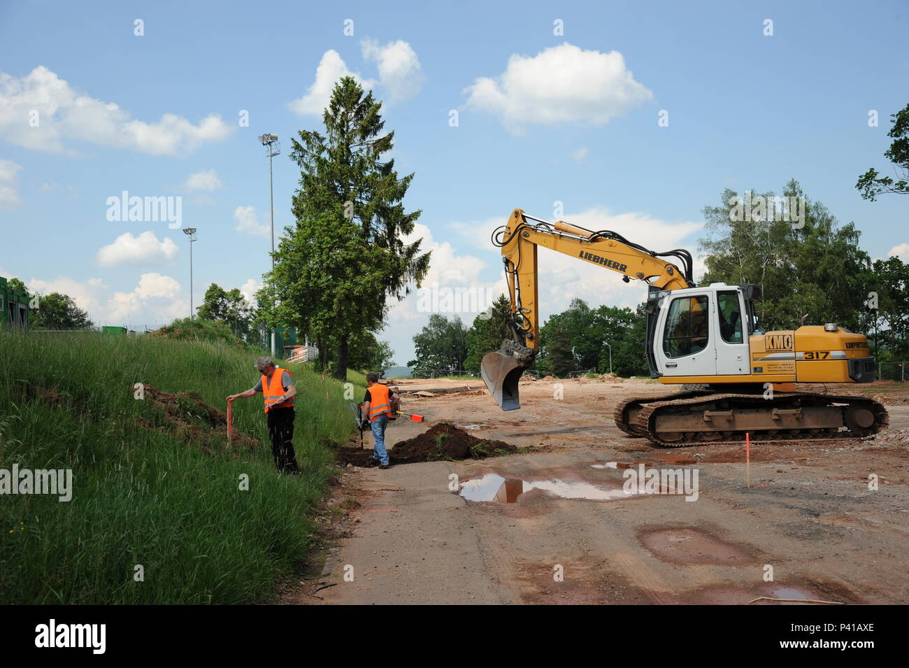 Excavation work close to the Soldier's Field (Sportsfield) near the Rheinlander Club in Baumholder, Germany, June 6, 2016. The Buildings 8688, 8687 and 8686 are already teared down. Here and below the Rheinlander Club Building will be build a total of 70 new Townhouses. Today a German Construction Company do groundworks and searching the area for aircraft bombs and other remains of World War II or metal that forget during the post-war era.  Baumholder was several times bombed by the U.S. Air Force and the British Royal Air Force in   World War II. You still find relics from wartime.   (U.S. Ar - Stock Image