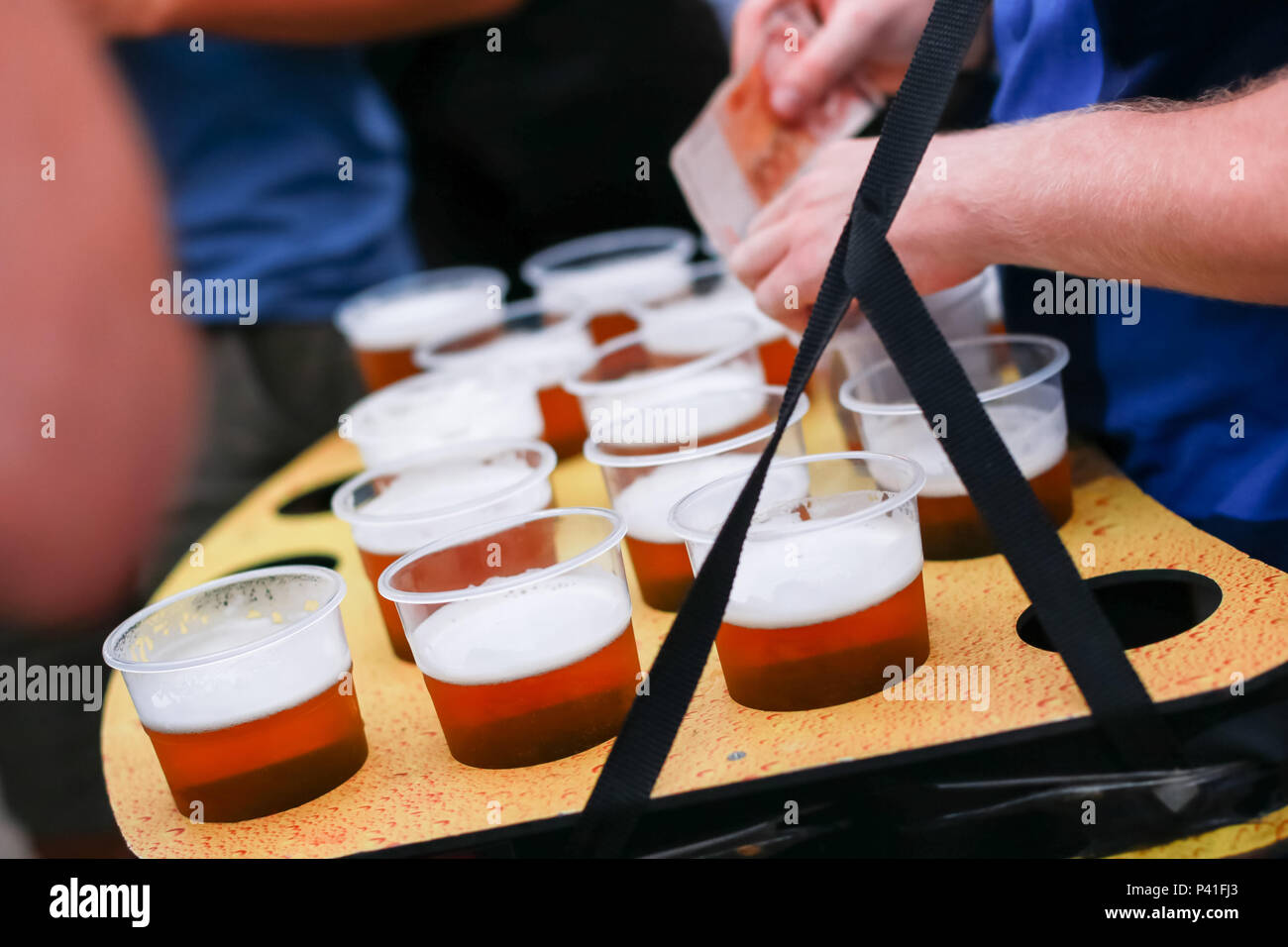 Close up of seller with the group of draft beers. - Stock Image