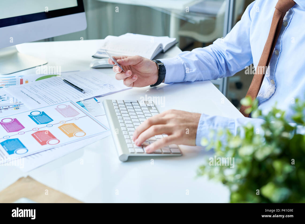 Crop businessman doing onling purchase - Stock Image