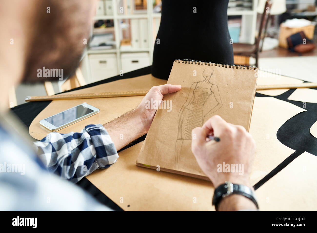 Crop designer creating sketch - Stock Image