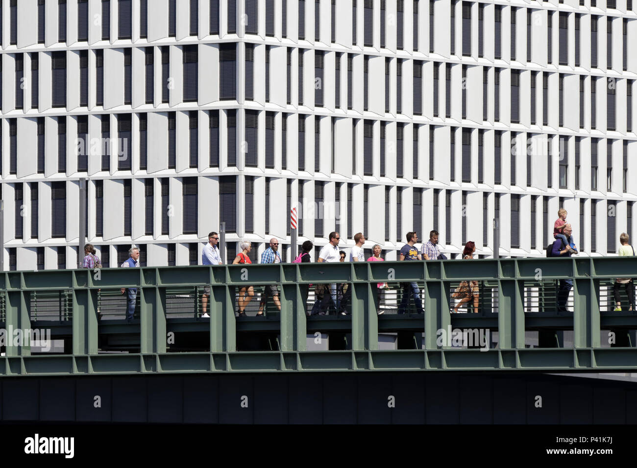 Berlin, Germany, passats on the Gustav-Heinemann-Bruecke in Berlin-Mitte, in the background the new building of a office building - Stock Image