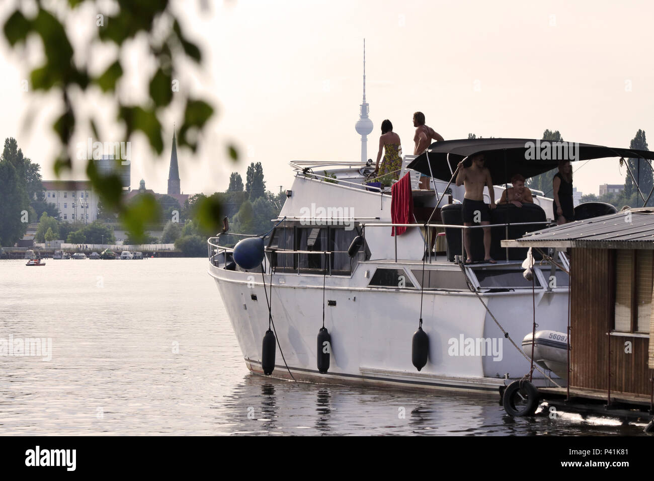 Berlin, Germany, Young people on a motorboat in Rummelsburger Bucht - Stock Image