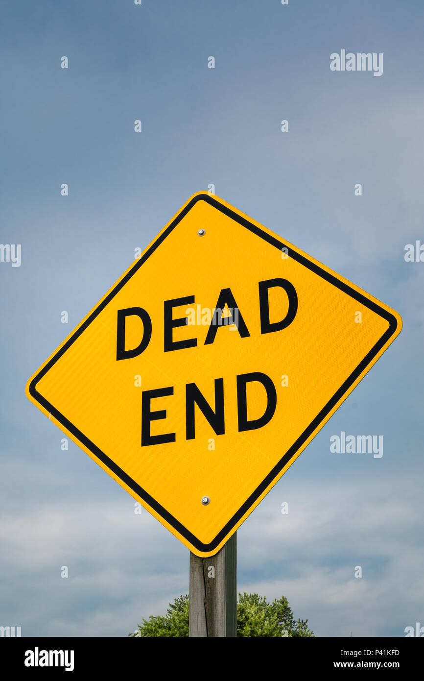 Dead End road sign in rural Illinois shining in the afternoon light. - Stock Image