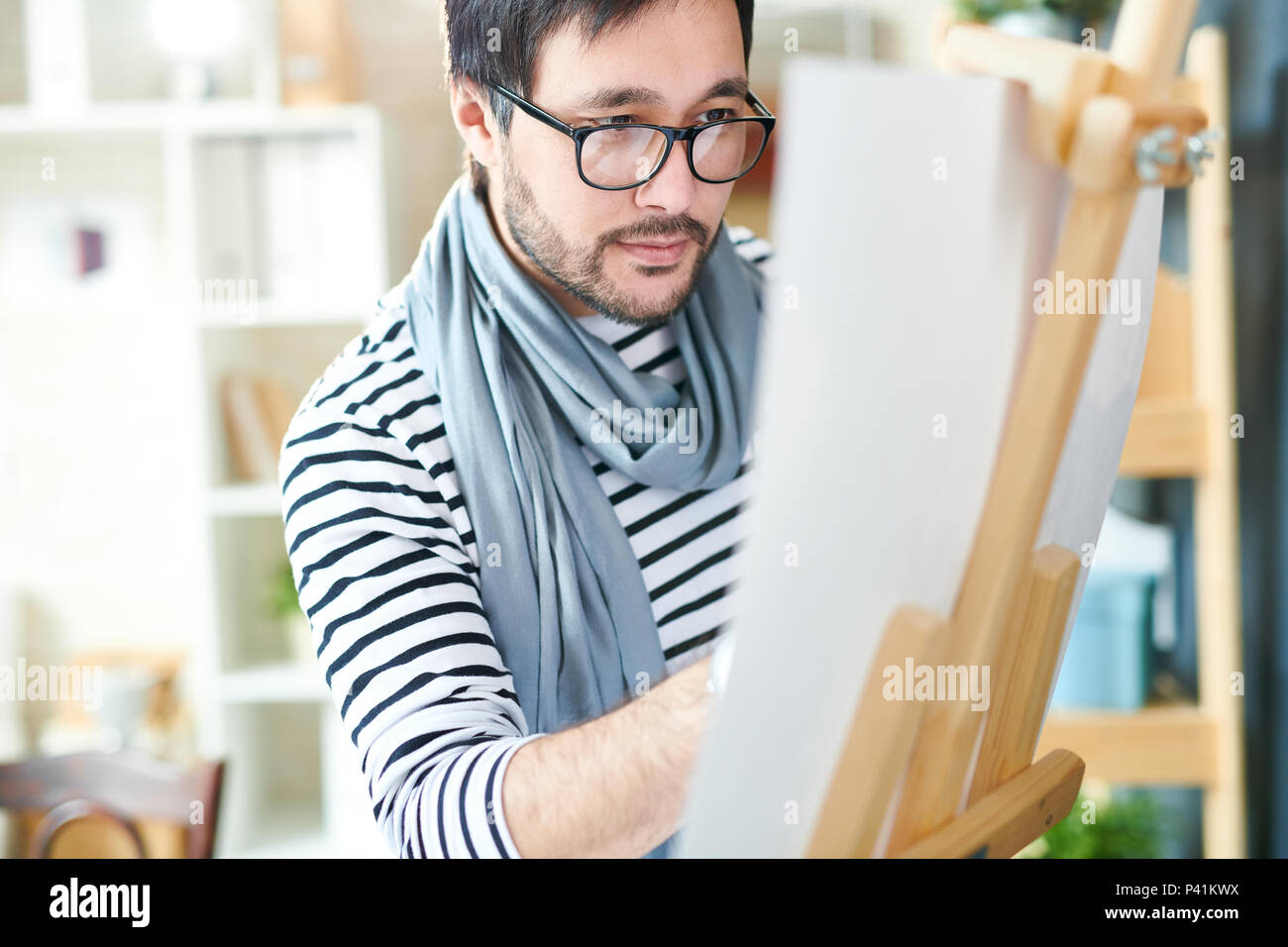 Bearded designer making art on paper - Stock Image