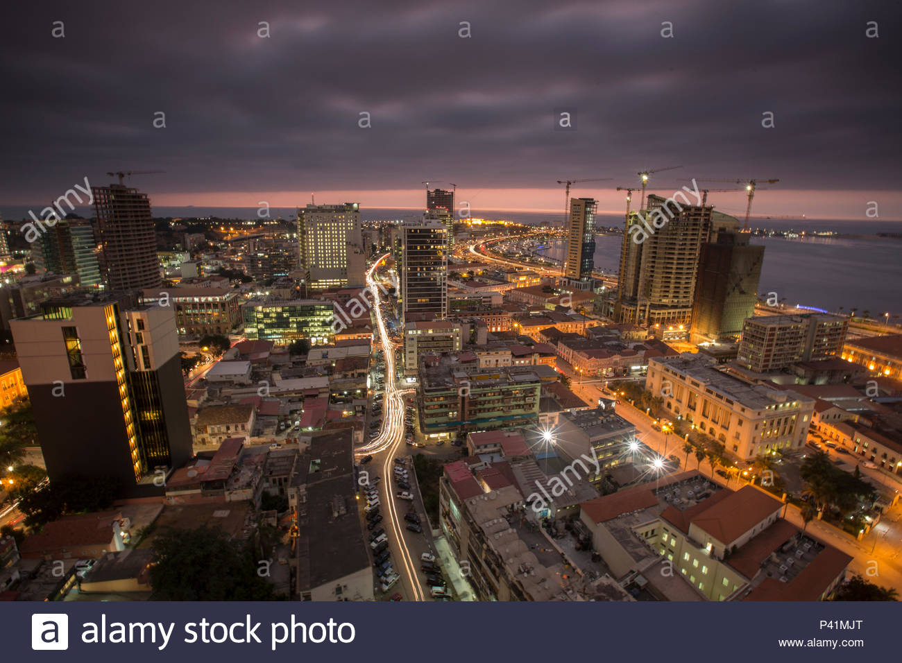 City lights and new construction in Luanda. - Stock Image