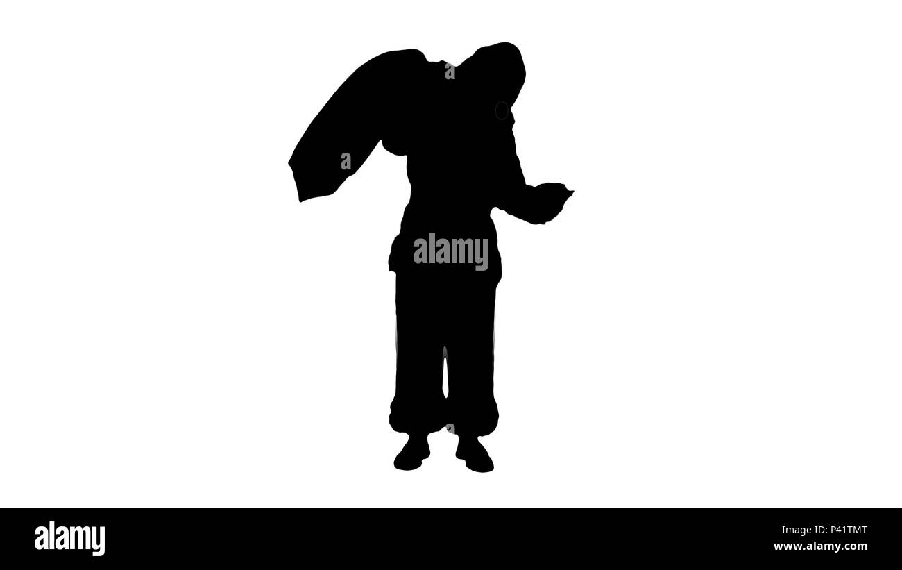 Silhouette Real Santa Claus carrying big bag full of gifts  - Stock Image