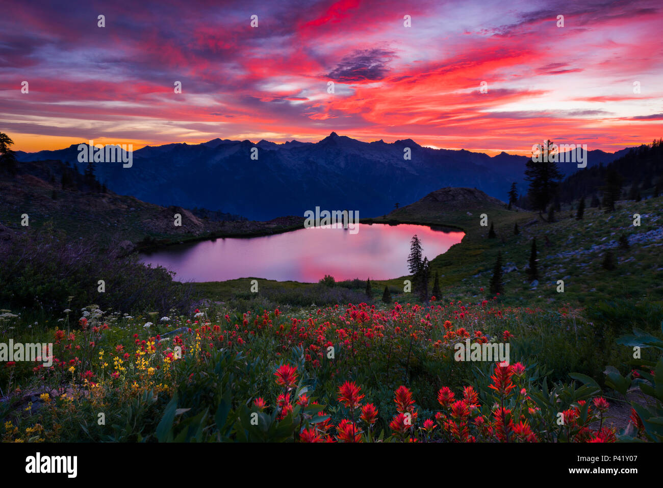 Amazing sunset over Diamond Lake in the Trinity Alps wilderness Four Lakes loop backpacking trail in California. - Stock Image