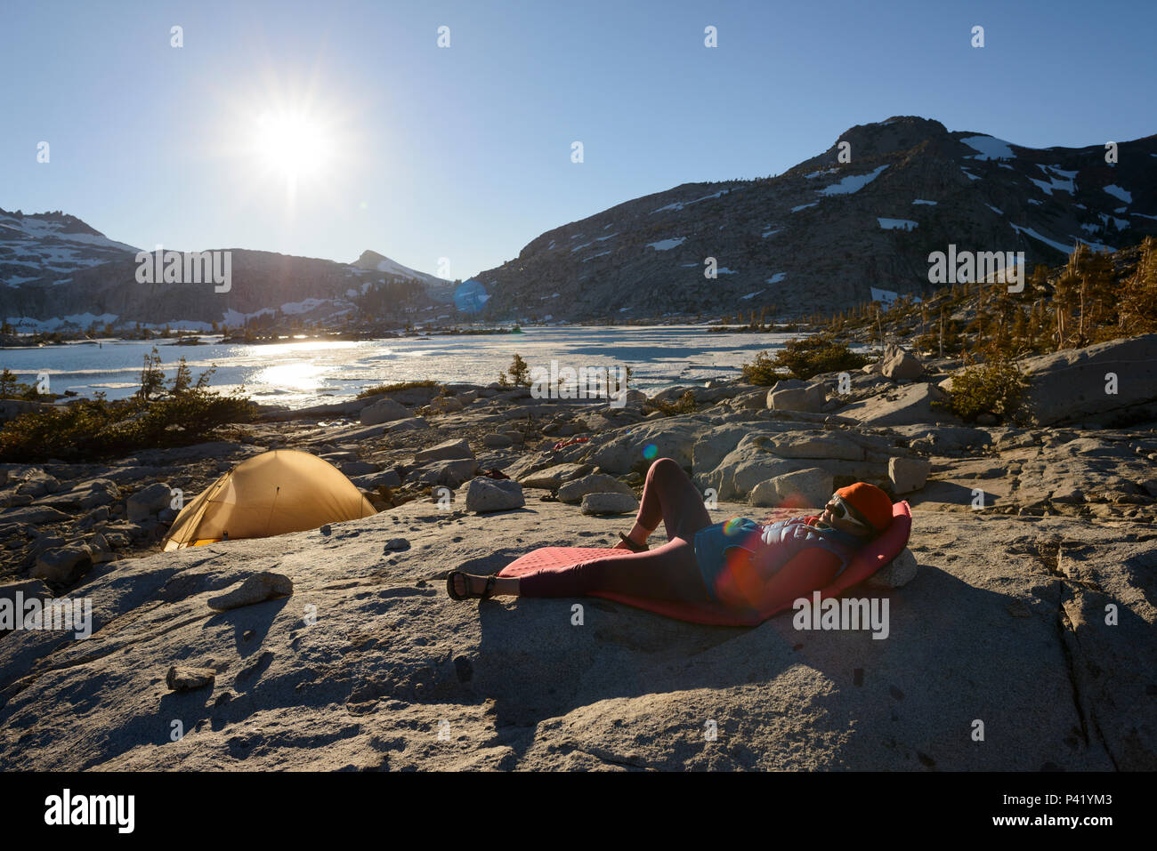 Backpacker at camp in the granite around Lake Aloha in the Desolation wilderness hike in south lake tahoe Stock Photo